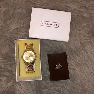 ⬇️ 110 Coach Gold Watch